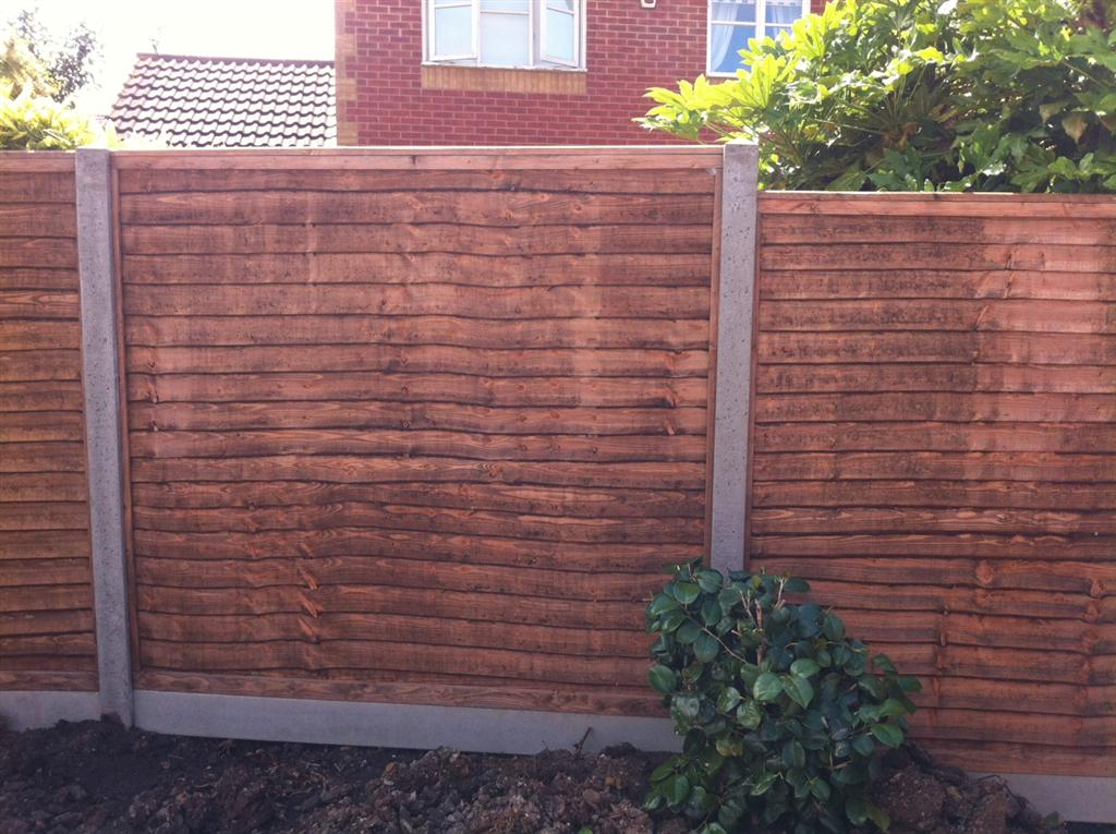 OVERLAP PANEL ON SLOTTED CONCRETE POST WITH CONCRETE GRAVEL BOARD, IN TAUNTON