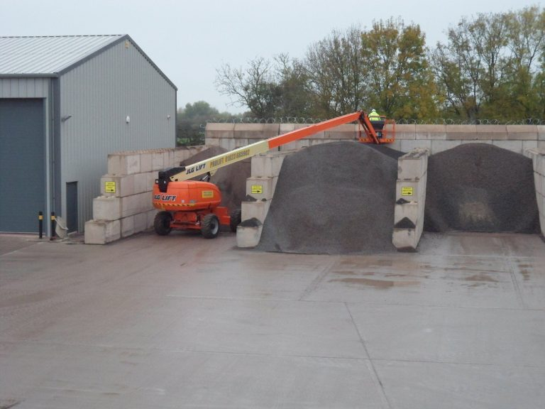 FITTING RAZOR WIRE ON TOP OF WALL FOR HOPKINS CONCRETE BRIDGWATER